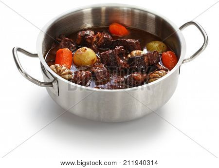beef bourguignon, beef stewed in red wine, french burgundy cuisine isolated on white background