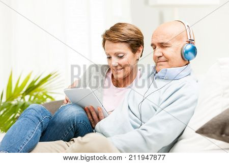 Mature Couple Displaying A Blank Tablet-pc