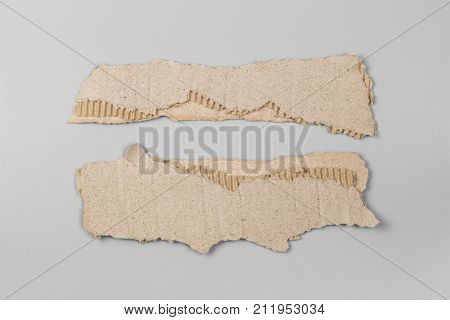 paper cut set. old paper of Packaging box isolated on gray background. brown paper rip