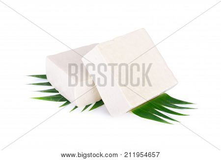 square tofu on banana leaf and on white background