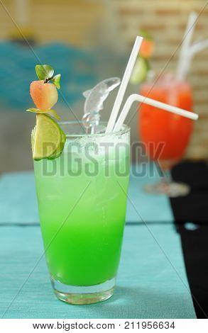 fresh fruit mocktail in glass with lemon