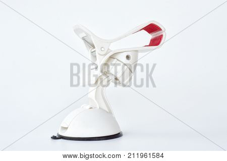 White car phone mount holder on white background .It is important when use smartphone while driving cause it can help reduce and prevent road accidents and can use the mobile while driving more easily