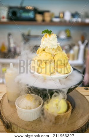 Durian bingsu or Korean shaved ice with smoke from dry ice