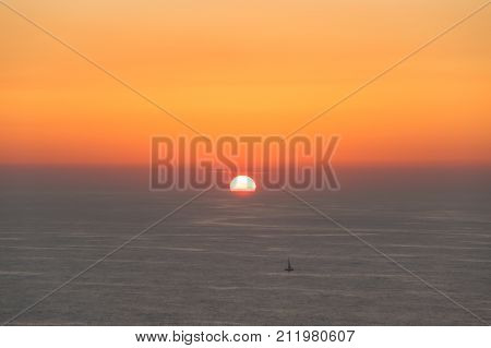 Sunset over Atlantic ocean. View from Cabo da Roca (Cape Roca) a cape which forms the westernmost extent of mainland Portugal and continental Europe