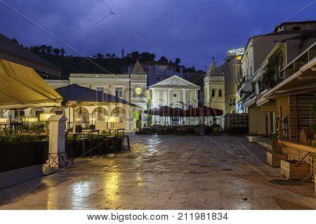 ZAKYNTHOS, GREECE - OCTOBER 7, 2017: Dawn in St Marco square in Zakynthos town, Greece on October 7, 2017.