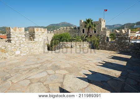 MARMARIS, TURKEY - AUGUST 12, 2009: View to the walls and tower of the Marmaris castle in Marmaris, Turkey.