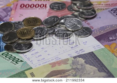 Spending Money and Payment Illustrated with money and receipt paper
