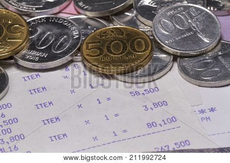 Spending Money and Payment Illustrated with coins, bank notes and receipt paper in close up