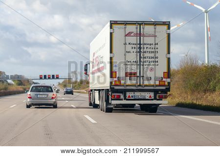 BRAUNSCHWEIG / GERMANY - OCTOBER 29 2017: truck from polish forwarder Omega Pilzno drives on german motorway A2.