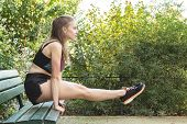 Beautiful fit young woman exercising in the park. Fall time. Health concept. Fitness concept. Concept of endurance and motivation. poster
