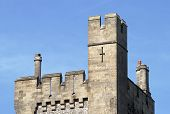 Top of square tower on Arundel Castle. West Sussex. England. With chimney pots. poster