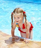 Little girl  swimming in pool. poster
