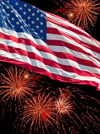 The American Flag And A Fireworks Display