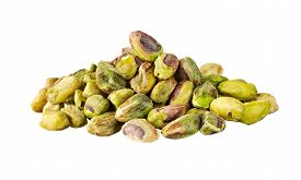 a heap of pistachio nuts isolated on white.
