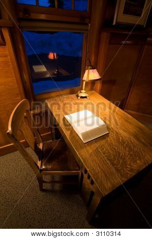 Desk With Lamp and Book