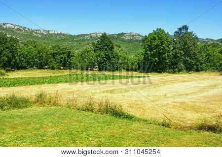 Bosnian Countryside Landscape On A Hot Summer Day. Mountain Valley In Dinaric Alps. Bosnia And Herze