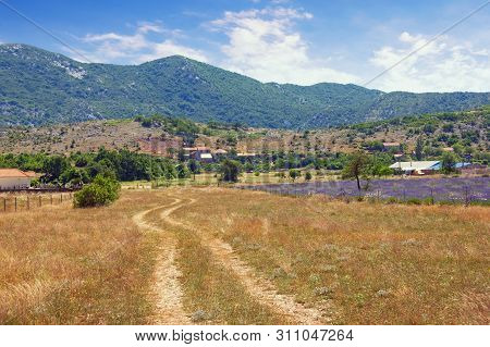 Mountain Valley In Dinaric Alps. Countryside With Country Road On A Sunny Summer Day. Bosnia And Her