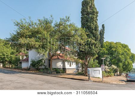 Barberton, South Africa - May 2, 2019: A Street Scene, With The All Saints Anglican Church, In Barbe