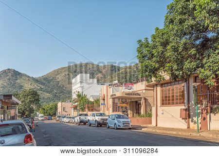 Barberton, South Africa - May 2, 2019: A Street Scene, With The Phoenix Hotel, Other Businesses And