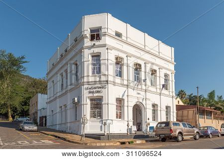 Barberton, South Africa - May 2, 2019: A Street Scene, With The Historic Lewis And Marks Building An