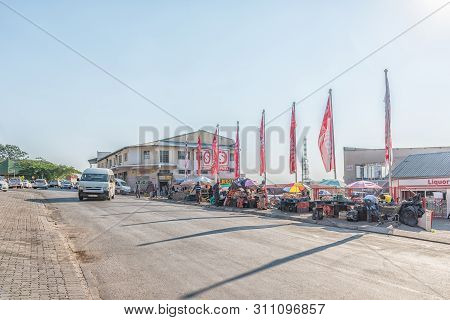 Barberton, South Africa - May 2, 2019: A Street Scene, With Businesses, Street Vendors And Vehicles,