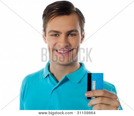 Close-up Portrait Of Fashionable Guy Holding Debit Card