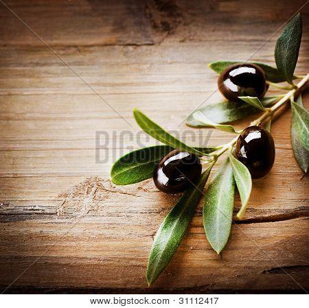 Olives over Wooden Background