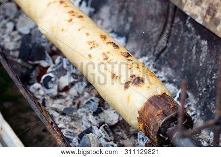 Traditional Potato Bread Chochoca From Chiloe Island Chile Prepared On Wooden Stick