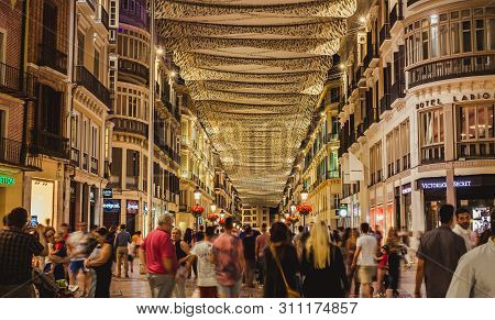 Malaga, Spain - June 22, 2018. People In Motion On The Marques De Larios Pedestrian Street At Night,