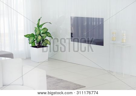 Interior Of The Living Room Of The Hotel. Beautiful Living Room With Tv. White Concept Living Room I