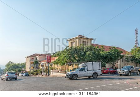 Barberton, South Africa - May 2, 2019: A Street Scene, With The Municipal Offices And Vehicles, In B