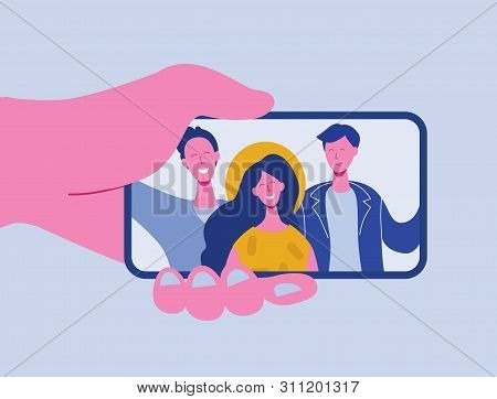 Hands Holding Mobile Phone With Happy Boys And Girls Displaying On Screen. Friends Posing For Selfie