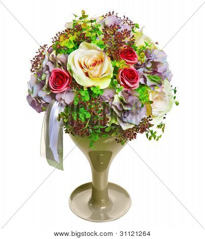 arrangement of flowers and ribbons in a glass vase