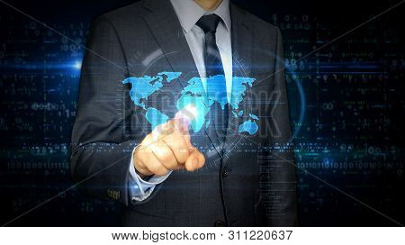 A Businessman In A Suit Touch The Screen With World Symbol Hologram. Man Using Virtual Display Inter
