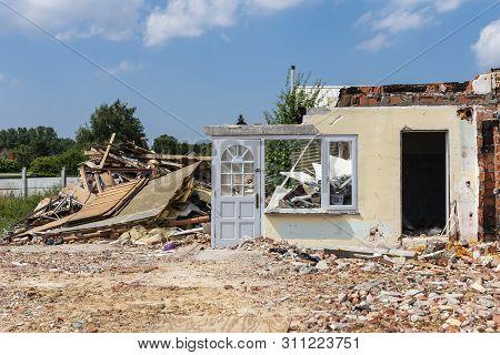 Sint Gillis Waas, Belgium, 11 July 2019, Old House For A Part Broken Off, The Front Door Is Still St