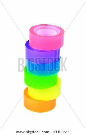 Tower of six rolls of coloured sticky tape.