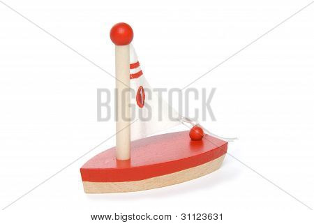 Wooden toy sailboat on white background