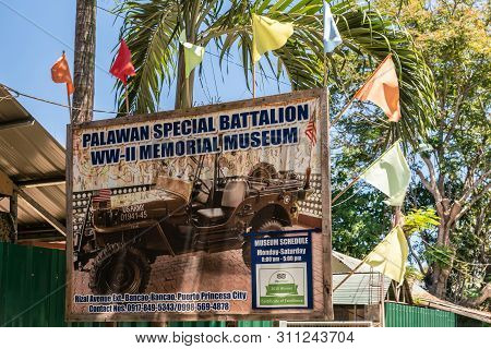 Puerto Princesa, Palawan, Philippines - March 3, 2019: Billboard With Image Of American Jeep Of Pala