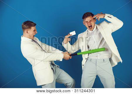 Businessman Batting Rival With Baseball Bat. Man Showing Finger Gun With Blank Card. Managers Shouti