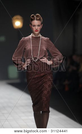 """ZAGREB, CROATIA - MARCH 17: Fashion model wears clothes made by Envy Room on """"Dove FASHION.HR"""" show on March 17, 2012 in Zagreb, Croatia."""