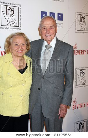 LOS ANGELES - MAR 18:  AC Lyles and wife arrives at the Professional Dancer's Society Gypsy Awards at the Beverly Hilton Hotel on March 18, 2012 in Los Angeles, CA