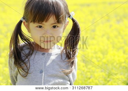 Japanese Girl And Field Mustard (4 Years Old)