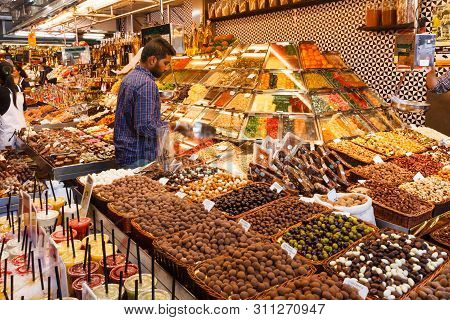 Barcelona, Spain-september 5th 2015: A  Stall Selling Olives And Dried Fruits In The Mercat De Sant
