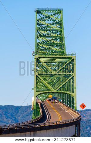 Close up view on Astoria-Megler Bridge, a steel cantilever through truss bridge in northwest United States spanning Columbia River between Astoria, Oregon, and Point Ellice near Megler, Washington. poster