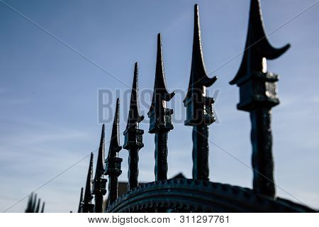 Closeup Of Black Metal Fence Spikes Perspective