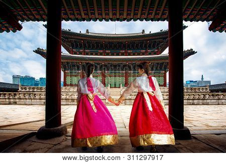 Korean Lady In Hanbok Or Korea Gress And Walk In An Ancient Town And Gyeongbokgung Palace In Seoul,