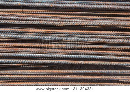 Reinforced Steel Bars On The Construction Site.. Metal Base Of Reinforced Concrete Walls. Part Of Th