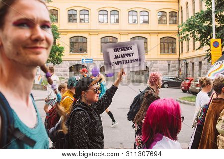 Helsinki, Finland - June 29, 2019: Woman With Poster