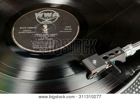 London, England - May 08, 2019: Vintage Vinyl Record With Wwa Label Played On The Turntable With Aud