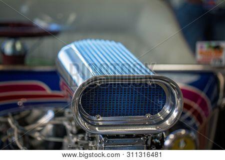Close Up Of Carburetor In Engine Of Custom Classic Vintage Car